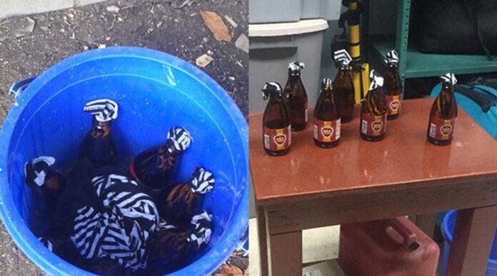 La Policía dijo haber encontrado un envase azul con botellas de cristal que se presume tenían una sustancia acelerante. (Facebook / Policía Area Ponce)